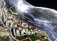 Dec 29, 2015; Houston, TX, USA; The LSU Tigers band is reflected in a sousaphone before LSU plays the Texas Tech Red Raiders in there Texas Bowl at NRG Stadium. LSU won 56 to 27. Mandatory Credit: Thomas B. Shea-USA TODAY Sports