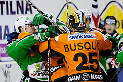 Roughing between Igor Cvetek (HDD Tilia Olimpija, #4) and Yvan Busque (Moser Medical Graz 99ers, #25) during ice-hockey match between HDD Tilia Olimpija and Moser Medical Graz 99ers in 42nd Round of EBEL league, on Januar 15, 2012 at Hala Tivoli, Ljubljana, Slovenia. HDD Tilia Olimpija defeated Moser Medical Graz 99ers 4:2. (Photo By Matic Klansek Velej / Sportida)