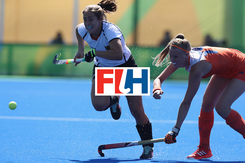 RIO DE JANEIRO, BRAZIL - AUGUST 13:  Marie Mavers of Germany breaks with the ball during the Women's group A hockey match between the Netherlands and Germany on Day 8 of the Rio 2016 Olympic Games at the Olympic Hockey Centre on August 13, 2016 in Rio de Janeiro, Brazil.  (Photo by David Rogers/Getty Images)