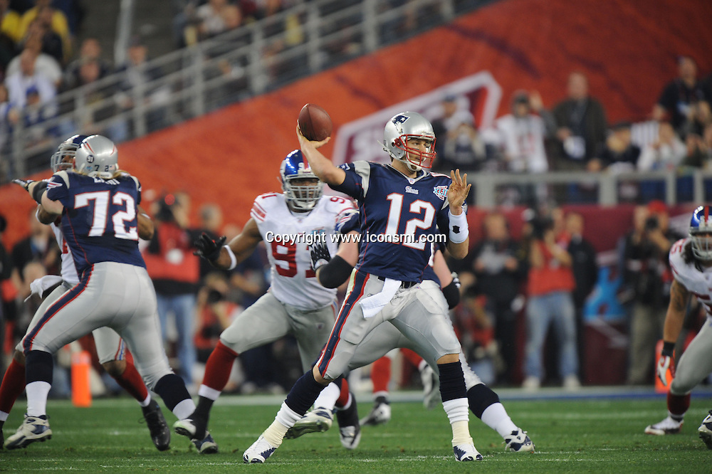 Feb 03, 2008 - Glendale, Arizona, USA - New England Patriots quarterback TOM BRADY passes the ball in the first quarter during the first quarter of Super Bowl XLII at University of Phoenix Stadium. The New England Patriots who went unbeaten during their 2007 season faced the New York Giants