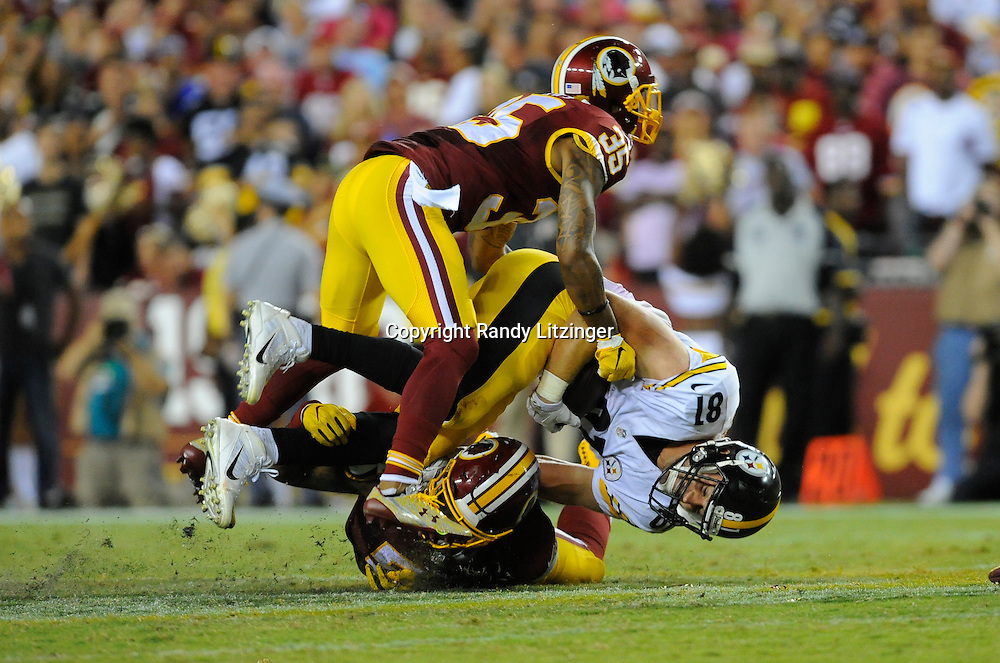12 September 2016:  The Redskins Dashaun Phillips (35) and Mason Foster (54) tackle Steelers TE Jesse James (81). The Pittsburgh Steelers defeated the Washington Redskins 38-16 on Monday Night Football at FedEx Field in Landover, MD. (Photo by Randy Litzinger/Icon Sportswire)