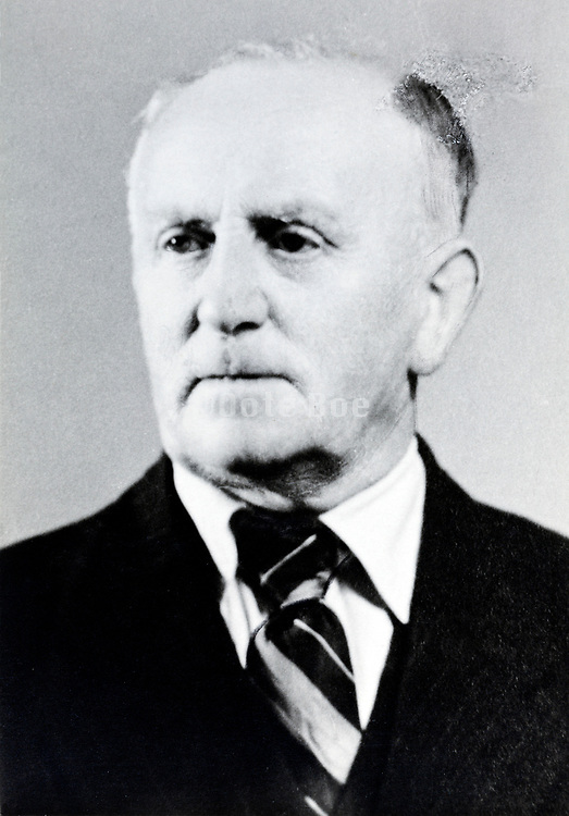 passport style portrait of elderly man 1960s
