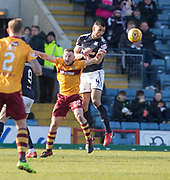 24th February 2018, Dens Park, Dundee, Scotland; Scottish Premier League football, Dundee versus Motherwell; Steven Caulker of Dundee heads clear from Allan Campbell of Motherwell