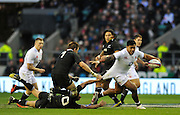 Twickenham, GREAT BRITAIN,    NZLs' Dan CARTER, grabs a hand full of Manu TUILAGI's, shirt during the QBE. Autumn International;  England vs New Zealand, Rugby match.  Autumn, International Test Series.  RFU. Twickenham Stadium, Surrey.  Saturday  01/12/2012..[Mandatory Credit; Peter Spurrier/Intersport-images]