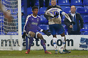 Nathan Trott of Wimbledon  saves from Rushian Hepburn-Murphy of Tranmere Rovers  during the EFL Sky Bet League 1 match between Tranmere Rovers and AFC Wimbledon at Prenton Park, Birkenhead, England on 21 December 2019.