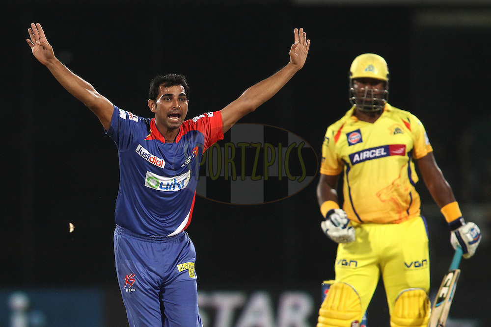 Mohammad Shami of the Delhi Daredevils appeals unsuccessfully for a catch during match 26 of the Pepsi Indian Premier League Season 2014 between the Delhi Daredevils and the Chennai Super Kings held at the Feroze Shah Kotla cricket stadium, Delhi, India on the 5th May  2014<br /> <br /> Photo by Shaun Roy / IPL / SPORTZPICS<br /> <br /> <br /> <br /> Image use subject to terms and conditions which can be found here:  http://sportzpics.photoshelter.com/gallery/Pepsi-IPL-Image-terms-and-conditions/G00004VW1IVJ.gB0/C0000TScjhBM6ikg