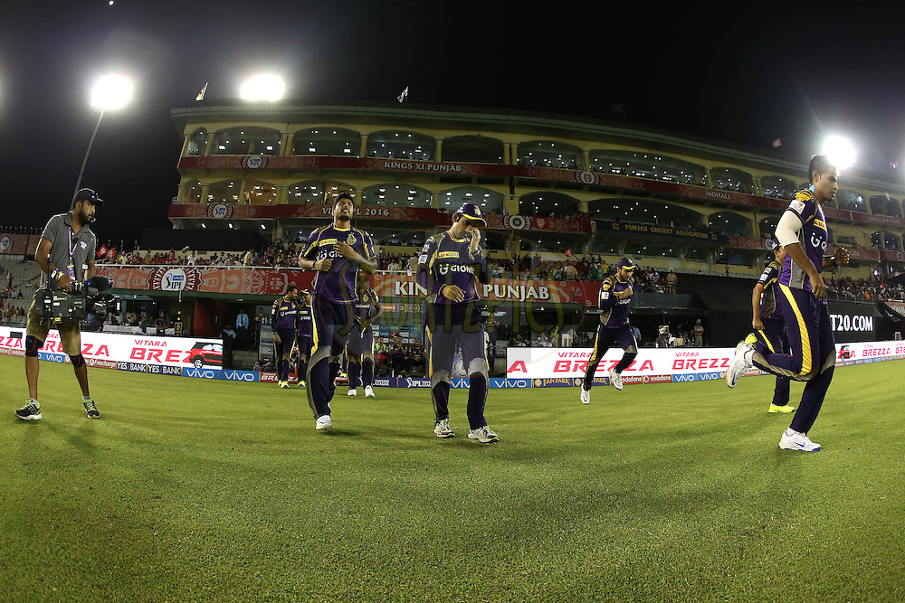 Kolkata Knight Riders players walks out at the start during match 13 of the Vivo Indian Premier League (IPL) 2016 between the Kings XI Punjab and the Kolkata Knight Riders held at the IS Bindra Stadium, Mohali, India on the 19th April 2016<br /> <br /> Photo by Shaun Roy / IPL/ SPORTZPICS