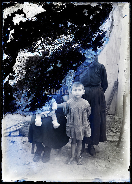 eroding glass plate photo with child grandmother mother and baby