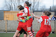 Megan Lynch is mobbed as she becomes the hero in the shootout during the Women's FA Cup match between Charlton Athletic WFC and Crystal Palace LFC at Sporting Club Thamesmead, Thamesmead, United Kingdom on 8 March 2015. Photo by Michael Hulf.