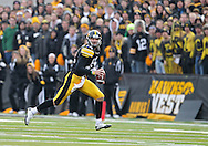 November 20 2010: Iowa Hawkeyes quarterback Ricky Stanzi (12) scrambles with the ball during the second quarter of the NCAA football game between the Ohio State Buckeyes and the Iowa Hawkeyes at Kinnick Stadium in Iowa City, Iowa on Saturday November 20, 2010. Ohio State defeated Iowa 20-17.