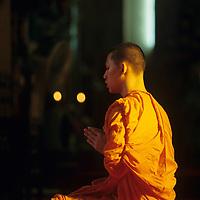 Thailand, Bangkok, Buddhist monk at morning prayers in Marble Temple