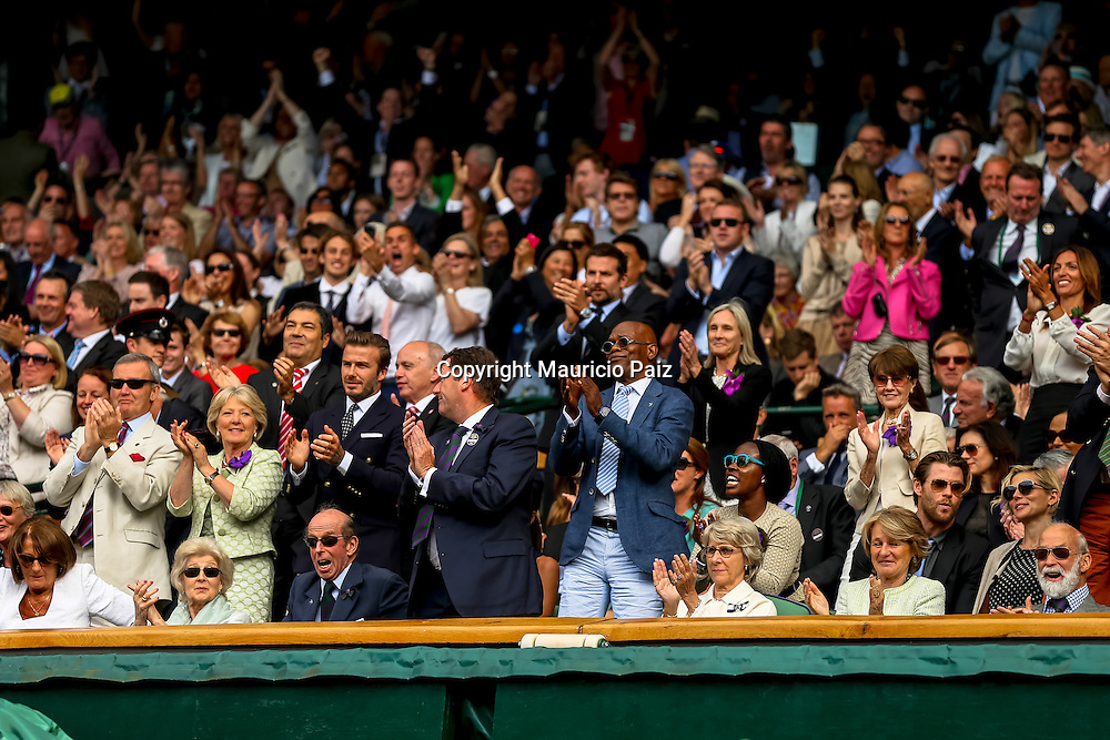 LONDON, ENGLAND - JULY 6: David Beckham, Samuel Jackson, Bradley Cooper, Chris Hemsworth and Elsa Pataky react during the Gentlemens' Singles final match on day thirteen of the Wimbledon Lawn Tennis Championships at the All England Lawn Tennis and Croquet Club at Wimbledon on July 6, 2014 in London, England.