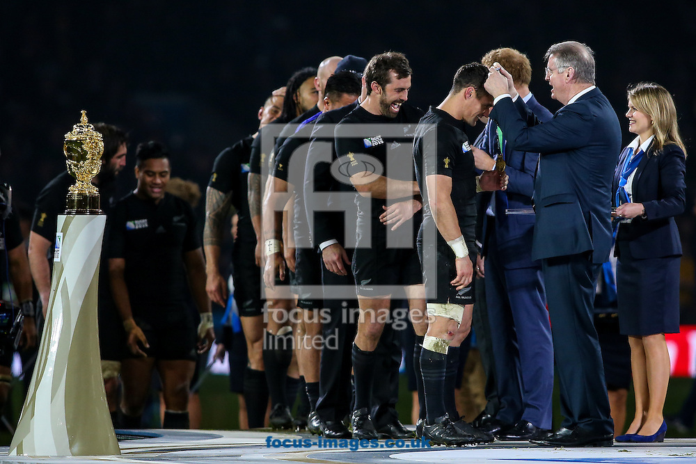 Dan Carter of New Zealand (third right) receives his winners medal from chairman of World erugby Bernard Lappasett after the final of the 2015 Rugby World Cup at Twickenham Stadium, Twickenham<br /> Picture by Andy Kearns/Focus Images Ltd 0781 864 4264<br /> 31/10/2015