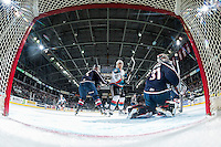 KELOWNA, CANADA - MARCH 4: Calvin Thurkauf #27 of the Kelowna Rockets looks for the puck in front of the net of Evan Sarthou #31 of the Tri-City Americans on March 4, 2017 at Prospera Place in Kelowna, British Columbia, Canada.  (Photo by Marissa Baecker/Shoot the Breeze)  *** Local Caption ***