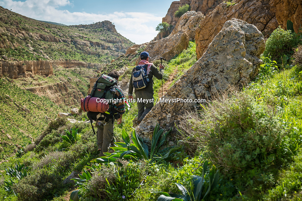 Palestine, March 2015. Hikers in Wadi Auja on the trail from Kafr Malek to Auja. The Abraham Path is a long-distance walking trail across the Middle East which connects the sites visited by the patriarch Abraham. The trail passes through sites of Abrahamic history, varied landscapes, and a myriad of communities of different faiths and cultures, which reflect the rich diversity of the Middle East. Photo by Frits Meyst / MeystPhoto.com for AbrahamPath.org