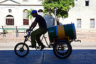 Bicitaxi hauling water in Holguin,Cuba.