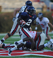 Ole Miss' Nickolas Brassell (2) runs around the end during a team scrimmage at Vaught-Hemingway Stadium in Oxford, Miss. on Saturday, August 20, 2011.