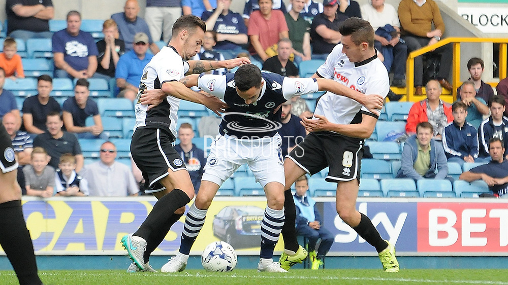Shaun Williams protects the ball during the Sky Bet League 1 match between Millwall and Rochdale at The Den, London, England on 26 September 2015. Photo by Michael Hulf.