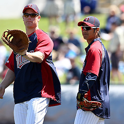 March 11, 2011; Fort Myers, FL, USA; Minnesota Twins first baseman Justin Morneau (33) and second baseman Tsuyoshi Nishioka (1) before a spring training exhibition game against the Boston Red Sox at Hammond Stadium.   Mandatory Credit: Derick E. Hingle