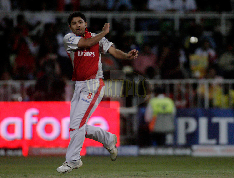 DURBAN, SOUTH AFRICA - 1 May 2009. Piyush Chawla has a throw at the stumps during the IPL Season 2 match between Kings X1 Punjab and the Royal Challengers Bangalore held at Sahara Stadium Kingsmead, Durban, South Africa.