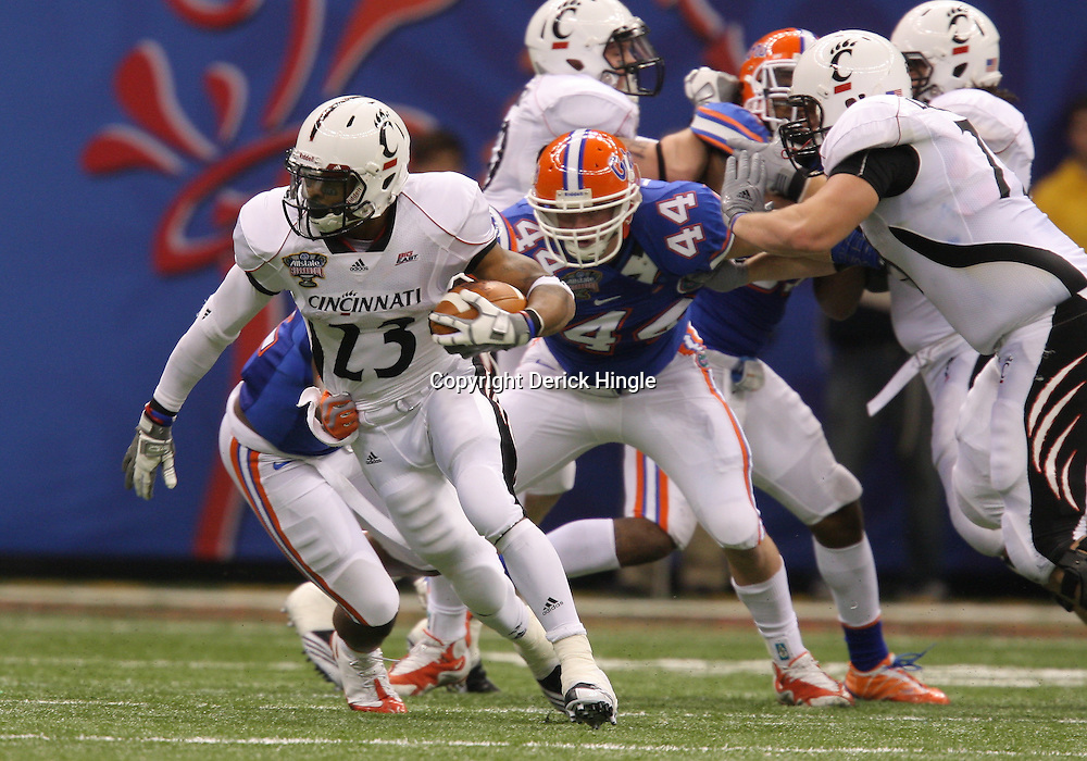 Jan 01, 2010; New Orleans, LA, USA;  Cincinnati Bearcats running back Isaiah Pead (23) runs with the ball against the Florida Gators during the 2010 Sugar Bowl at the Louisiana Superdome. Florida defeated Cincinnati 51-24.  Mandatory Credit: Derick E. Hingle-US PRESSWIRE.