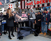 Wendy Williams poses to unveil PETA Campaign poster in Times Square in New York City, New York on November 28, 2012. Photo by Donna Ward/ABACAUSA.COM