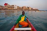 30 year old Modu Samba, a fisherman from Senegal, heads out to sea from the 400 year old fishing village of Ngor, Dakar, Senegal, 14 April 2010. Heavy fishing by international companies has put great pressure on traditional fishing communities. Highlighted as one of the main causes for the lack of fish today is the deals that have been struck over the last 50 years between the governments of West African nations and the countries owning large fishing fleets from Europe and Asia. These deals have benefitted the West African governments financially but not the people they govern. The foreign countries enjoying the fertile fishing grounds have been accused of overexploiting the resources and ultimately depleting the fishing stocks once the livelihood of the artisanal fishermen. Often in traditional fishing communities, fish are an important food source, and fishing is a way of life and basis for local cultures. As fish populations decline, stocks move offshore, making them inaccessible to small-scale, artisanal fishermen who do not have equipment to access offshore stocks.