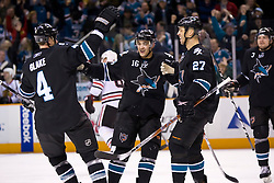 January 28, 2010; San Jose, CA, USA; San Jose Sharks center Manny Malhotra (27) is congratulated by right wing Devin Setoguchi (16) and defenseman Rob Blake (4) after scoring a goal during the third period at HP Pavilion. Chicago defeated San Jose 4-3 in overtime. Mandatory Credit: Jason O. Watson / US PRESSWIRE