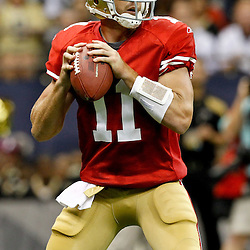 August 12, 2011; New Orleans, LA, USA; San Francisco 49ers quarterback Alex Smith (11) against the New Orleans Saints during the first half of a preseason game at the Louisiana Superdome. Mandatory Credit: Derick E. Hingle