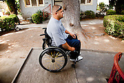 Rudy Ramirez on the wheelchair ramp entrance to his home. He became paralyzed in 2007 when he was shot 14 times in gang-related violence. Oxnard, Calif. (photo by Gabriel Romero ©2011)
