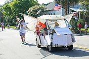 A golf cart decorated as a shrimp boat during the annual Sullivan's Island Independence Day parade July 4, 2017 in Sullivan's Island, South Carolina. The tiny affluent sea island hosts a bicycle and golf cart parade through the historic village.