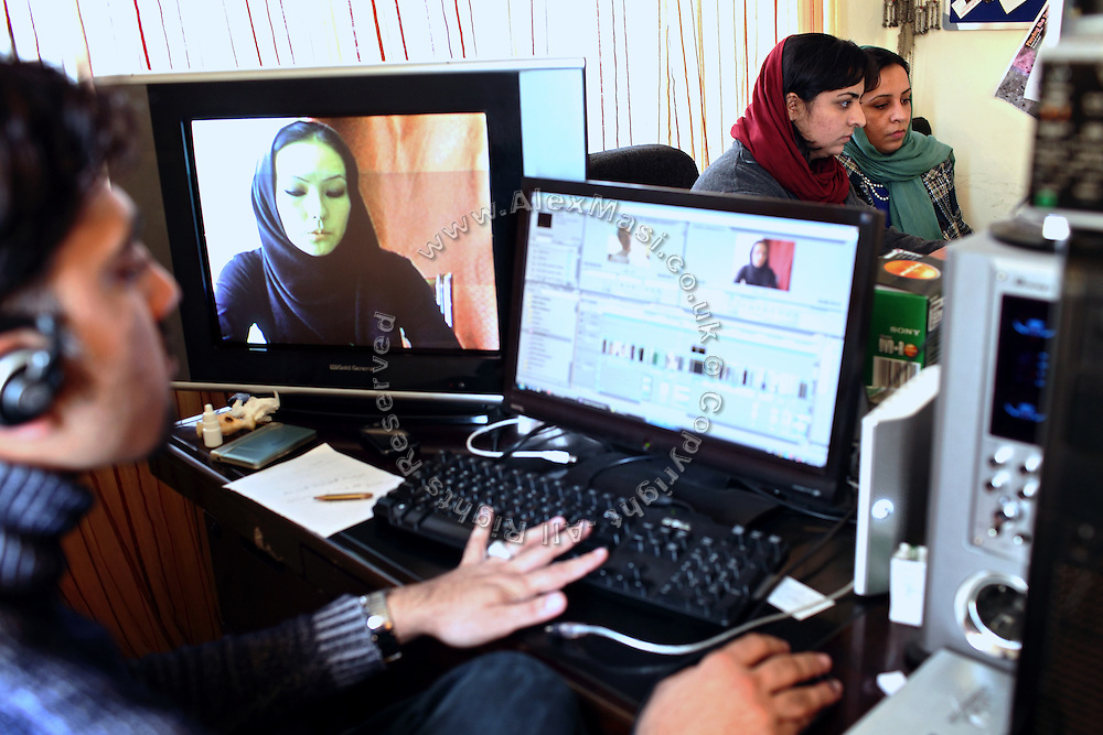 Roya Sadat, 28, (right) and Alka Sadat, 24, (centre), two sisters working on documentary and fiction film, are sitting at their desk while editing their recent shooting in their home in Kabul, Afghanistan. Aziz Dilder, 28, (left) a teacher at the cinema department of the fine art faculty of Kabul University is collaborating with the two brave sisters since about one year. Roya's most famous production is titled 'Three Dots' and it is an award-winning film that tells the story of women's village life in the province of Herat in western Afghanistan.