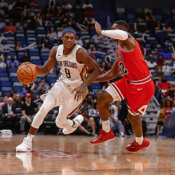 Oct 3, 2017; New Orleans, LA, USA; New Orleans Pelicans guard Rajon Rondo (9) drives past Chicago Bulls guard Kris Dunn (32) during the second half of a NBA preseason game at the Smoothie King Center. The Bulls defeated the Pelicans 113-109. Mandatory Credit: Derick E. Hingle-USA TODAY Sports