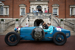 © Licensed to London News Pictures. 13/07/2015. Epsom, UK. VIOLA PROCOVIO and JESSICA DICKSON ready their 1927 Bugatti Type 37A at the start line in front of Woodcote Park. The start of The Royal Automobile Club 1000 Mile Trial 2015 at Woodcote Park in Epsom, Surrey. The event, which starts and finishes at Woodcote Park, takes a fleet of over 40 classic cars from around the world, through a 1000 mile trial around the UK.  Photo credit: Ben Cawthra/LNP