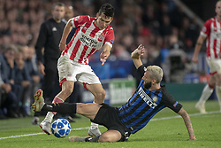 October 4, 2018 - Eindhoven, Netherlands - Hirving Lozano of PSV fights for the ball with Marcelo Brozovic of Inter during the UEFA Champions League Group B match between PSV Eindhoven and FC Internazionale Milano at Philips Stadium in Eindhoven, Holland on October 3, 2018  (Credit Image: © Andrew Surma/NurPhoto/ZUMA Press)