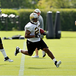 July 29, 2011; Metairie, LA, USA; New Orleans Saints running back Pierre Thomas (23) runs past linebacker Jonathan Vilma (51) during the first day of training camp at the New Orleans Saints practice facility. Mandatory Credit: Derick E. Hingle