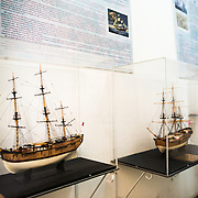 Some of the intricate scale models of ships on display at the Maritime Museum of Ushuaia. The museum consists of several wings devoted to maritime history, Antarctic exploration, an art gallery, and a policy and penitentiary museum. The complex is housed in an historic prison building and uses the original cells and offices as exhibit spaces.