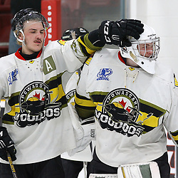 TRENTON, ON  - MAY 5,  2017: Canadian Junior Hockey League, Central Canadian Jr. &quot;A&quot; Championship. The Dudley Hewitt Cup Game 7 between Georgetown Raiders and the Powassan Voodoos.    Dayton Murray #20 taps  Nate McDonald #33 of the Powassan Voodoos on the head post game.<br /> (Photo by Alex D'Addese / OJHL Images)