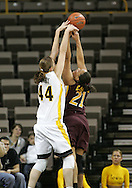 25 JANUARY 2007:  Iowa center Megan Skouby (44) blocks the shot of Minnesota forward/center Ashley Ellis-Milan (21) in Iowa's 80-78 overtime loss to Minnesota at Carver-Hawkeye Arena in Iowa City, Iowa on January 25, 2007.