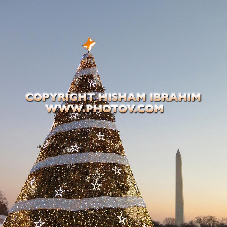 The National Christmas Tree Illuminated at Dusk at The White House, The Washington Monument seen at background, Washington DC, USA.