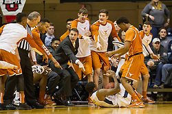 Jan 20, 2016; Morgantown, WV, USA; The Texas Longhorns bench reacts during the first half against the West Virginia Mountaineers at the WVU Coliseum. Mandatory Credit: Ben Queen-USA TODAY Sports