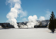 Cross-country skier silhouetted by geothermal steam, Yellowstone National Park