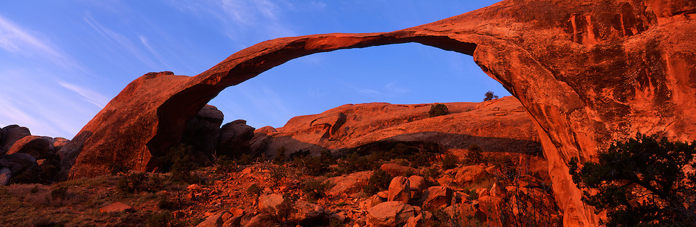 USA, Utah, Arches National Park, Rising winter sun lights Landscape Arch in Devil's Playground area
