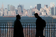 PHOTO PETER PEREIRA/4SEE<br /> <br /> New York City can be seen in the background as two men walk in oposite directions in Staten Island.  New Yorkers deal with the 10th anniversary of September 11, 2001 in different ways.