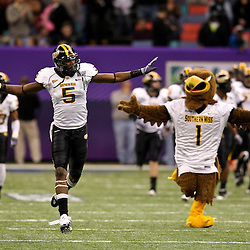 Dec 20, 2009; New Orleans, LA, USA; Southern Miss Golden Eagles wide receiver DeAndre Brown (5) and the mascot mimic each other as they run on to the field with the team prior to kickoff of the 2009 New Orleans Bowl at the Louisiana Superdome. Middle Tennessee State defeated Southern Miss 42-32. Mandatory Credit: Derick E. Hingle-US PRESSWIRE
