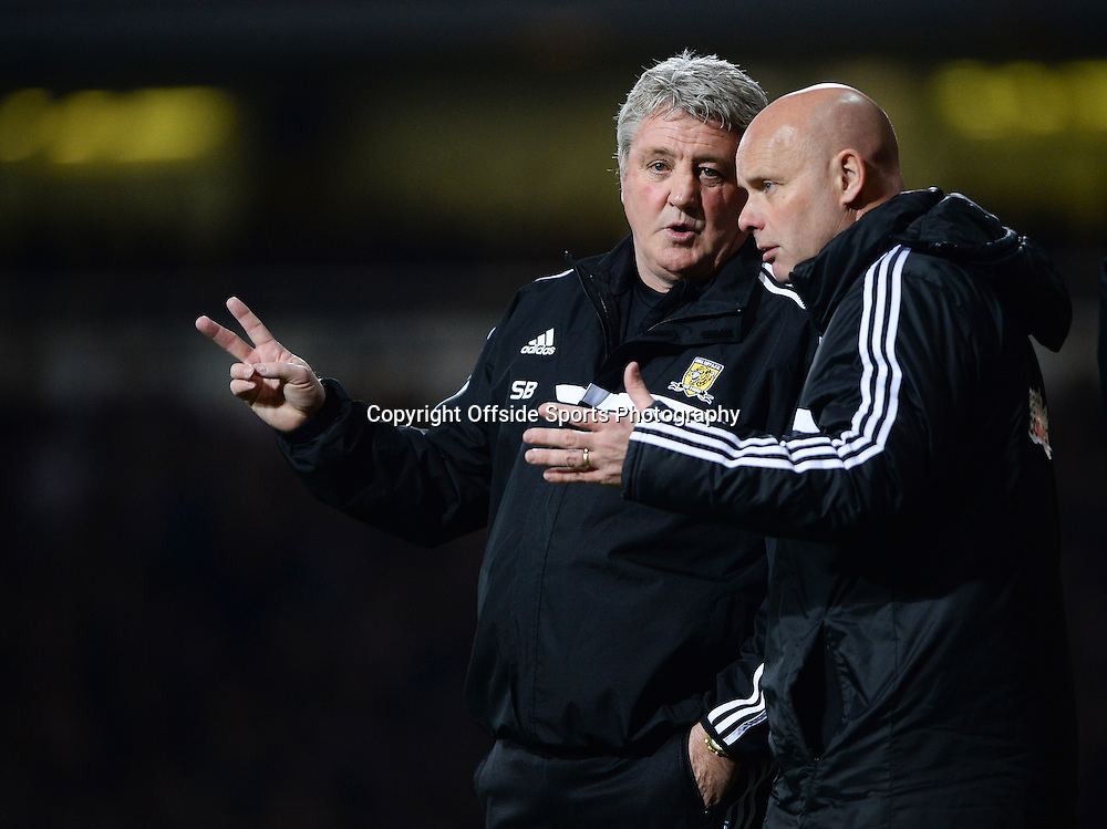 26 March 2014 - Barclays Premier League - West Ham United v Hull City - Steve Bruce, Manager of Hull City with assistant, Steve Agnew - Photo: Marc Atkins / Offside.