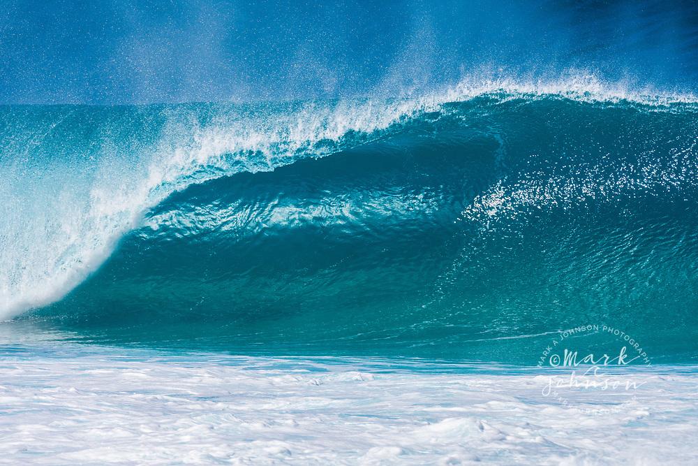 A beautiful blue wave breaking at the Banzai Pipeline, North Shore, Oahu, Hawaii