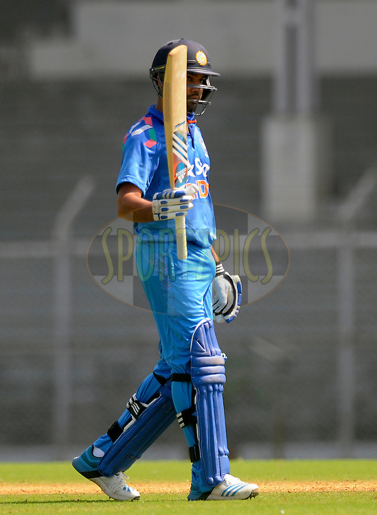 Rohit Sharma of India raises his bat after scoring a century during the practice match between India A and Sri Lanka held at the CCI Stadium, Mumbai,  India on the 30th October 2014<br /> <br /> Photo by:  Pal Pillai/ Sportzpics/ BCCI