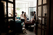 "YANGON, MYANMAR, MARCH 2012: The girls meeting the fashion stylist in their manager's apartment.<br /> Burma is a country in Transition. And if that hasn't been made clear enough by the political debates and the recent by-elections, meet the Me N Ma Girls, the first girlband in the country.<br /> The timing couldn't be better. After the April 1st elections in 2012 an always increasing number of investors from all over the world has been visiting Myanmar. After decades of military regime and isolation, the strings of censorship have started loosening up. The government censors in fact for years have banned songs and articles, deleting anything that was seen as ""to provocative"" such as leather outfits and colored wigs.<br /> Describing themselves as Myanmar's first all-girl group, under the management of the Australian dancer and choreographer Nicole May, these five women - coming from either Buddhist or Catholic background and formerly known as Tiger Girls - not only have been challenging censorship laws but they're as well trying to win hearts in a society that in many ways remains man-dominated and socially conservative.<br /> In a country that has been locked up for years, the Me N Ma Girls, embracing western pop culture with skimpy outfits and catchy songs, show with every performance the will of the Burmese youth to come out of a decades-long isolation.<br /> Five girls leading a new form of rebellion: the kind that questions roles and cultural norms."