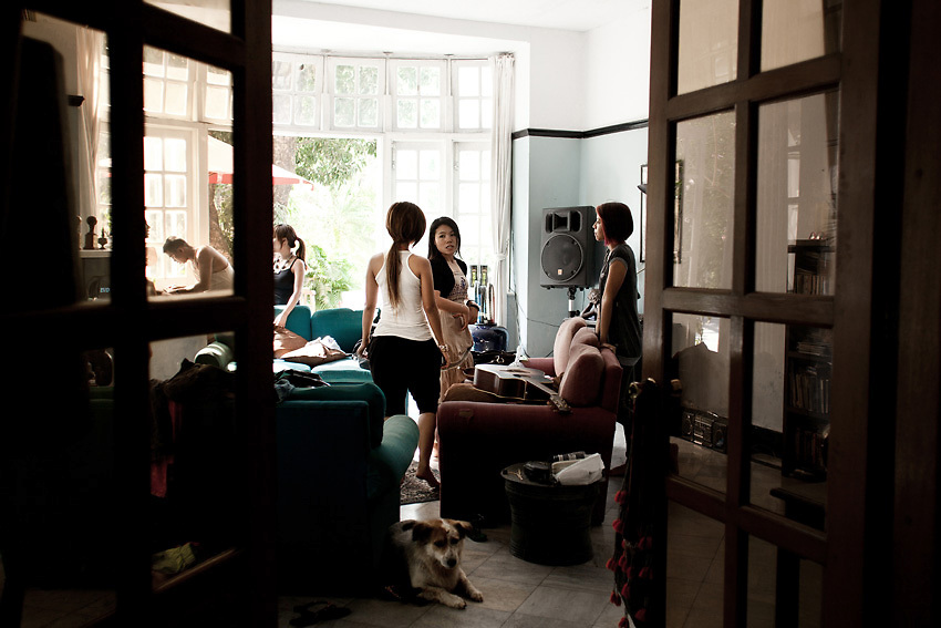 YANGON, MYANMAR, MARCH 2012: The girls meeting the fashion stylist in their manager's apartment.<br /> Burma is a country in Transition. And if that hasn't been made clear enough by the political debates and the recent by-elections, meet the Me N Ma Girls, the first girlband in the country.<br /> The timing couldn't be better. After the April 1st elections in 2012 an always increasing number of investors from all over the world has been visiting Myanmar. After decades of military regime and isolation, the strings of censorship have started loosening up. The government censors in fact for years have banned songs and articles, deleting anything that was seen as &quot;to provocative&quot; such as leather outfits and colored wigs.<br /> Describing themselves as Myanmar's first all-girl group, under the management of the Australian dancer and choreographer Nicole May, these five women - coming from either Buddhist or Catholic background and formerly known as Tiger Girls - not only have been challenging censorship laws but they're as well trying to win hearts in a society that in many ways remains man-dominated and socially conservative.<br /> In a country that has been locked up for years, the Me N Ma Girls, embracing western pop culture with skimpy outfits and catchy songs, show with every performance the will of the Burmese youth to come out of a decades-long isolation.<br /> Five girls leading a new form of rebellion: the kind that questions roles and cultural norms.